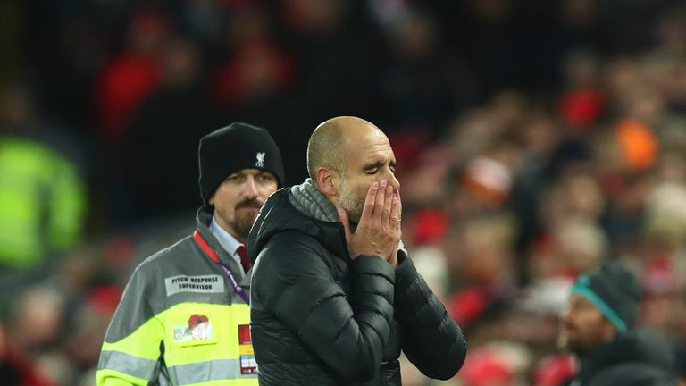 A dejected Pep Guardiola reacts during City's defeat