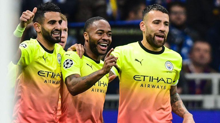 Raheem Sterling celebrates after scoring Manchester City's opening goal at Atalanta