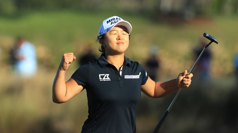 Kim sinks long birdie to win biggest prize in women's golf