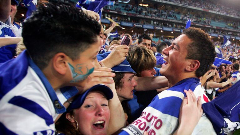 Sonny Bill Williams celebrates with Bulldogs fans after winning the 2004 Grand Final