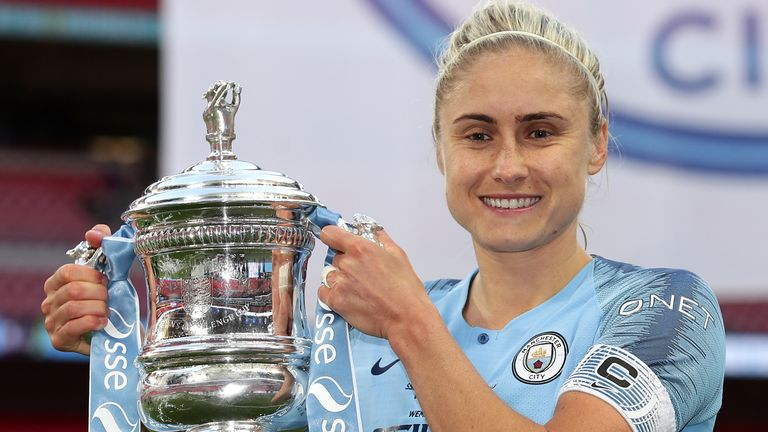Manchester City captain Steph Houghton celebrates with the trophy after they beat West Ham in the 2019 Women's FA Cup