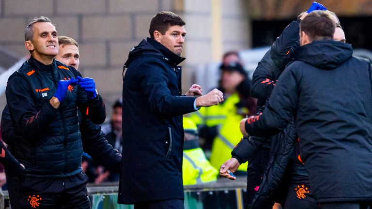 Steven Gerrard celebrates on the touchline at the Tony Macaroni Arena