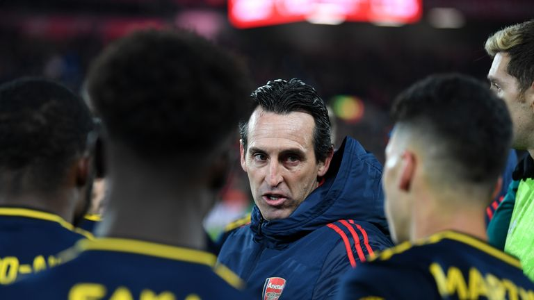 Unai Emery gives instructions to his players at Anfield