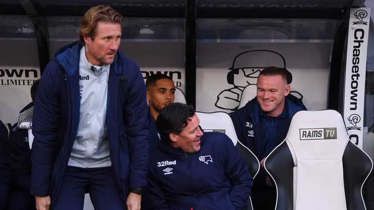 Rooney watched from the Derby dugout against QPR last month