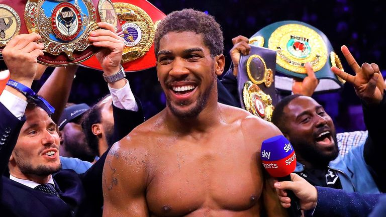 Britain's heavyweight star regained the IBF, WBO and WBA belts