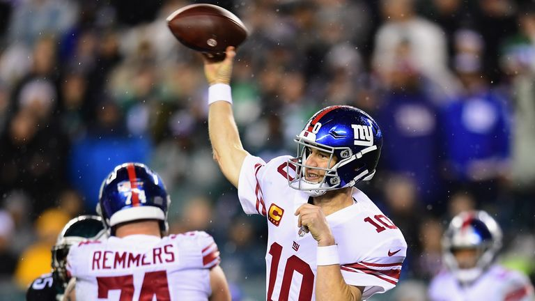 Quarterback Eli Manning of the New York Giants delivers a pass over the defense of the Philadelphia Eagles