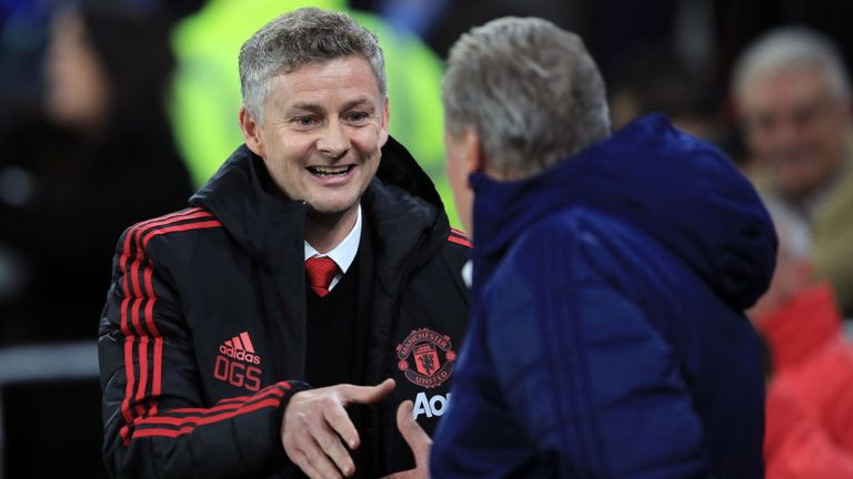 Ole Gunnar Solskjaer greets Cardiff manager Neil Warnock ahead of his first game in charge of Manchester United