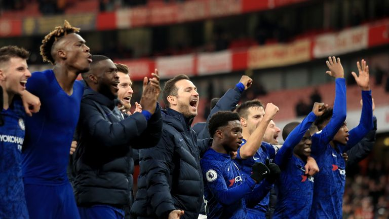 Lampard and the Chelsea players celebrate the win at Arsenal