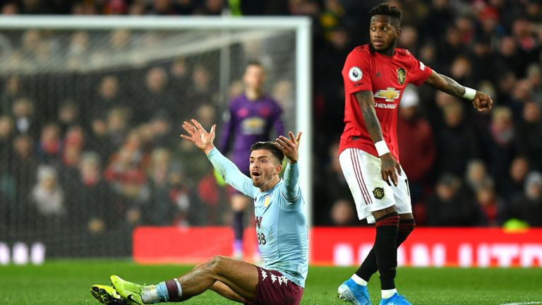 Grealish appeals to the referee during Villa's draw at Manchester United