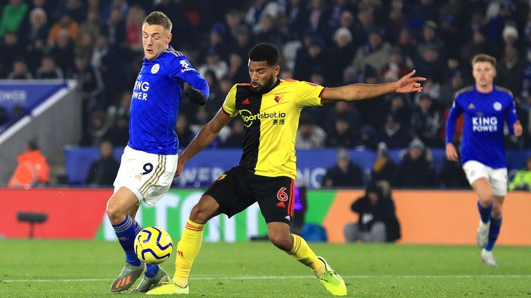 Jamie Vardy is challenged by Adrian Mariappa - but is booked for simulation