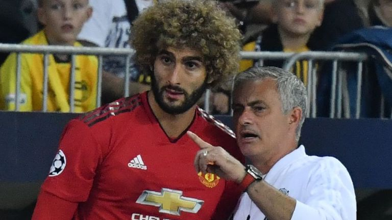 Marouane Fellaini (left) is still in contact with Jose Mourinho