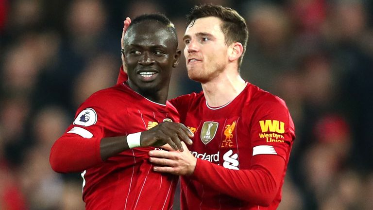 Liverpool's Andy Robertson and Sadio Mane celebrate going 1-0 up against Wolves