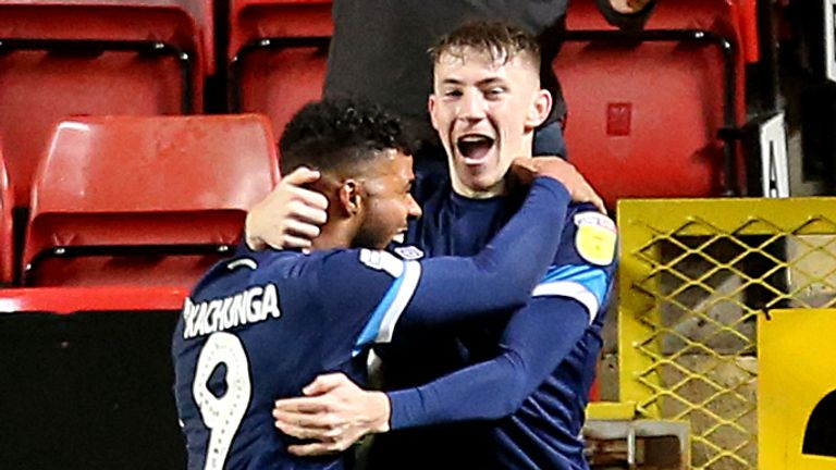 Huddersfield Town's Matty Daly (right) celebrates scoring his side's winner