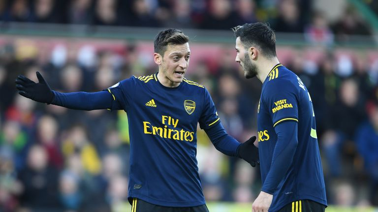 Mesut Ozil and Saed Kolasinac in deep discussion during Arsenal's trip to Norwich