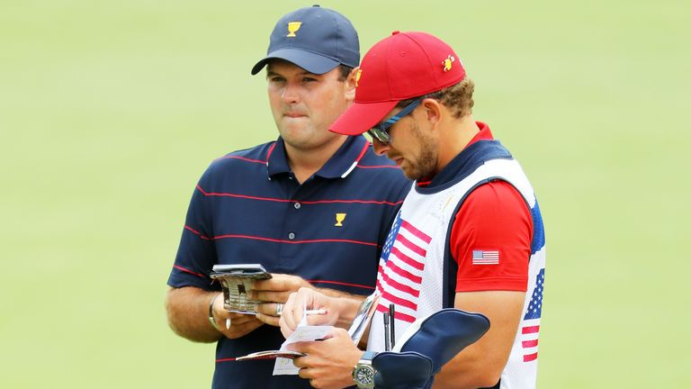 Patrick Reed talks with his caddie Kessler Karain