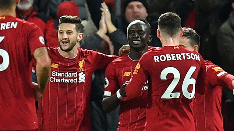 Sadio Mane celebrates with team-mates after scoring Liverpool's fourth goal