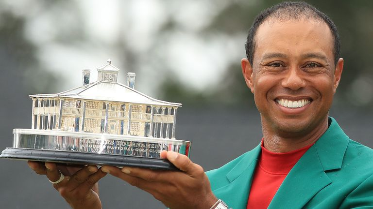Tiger with his prize after winning the 2019 Masters