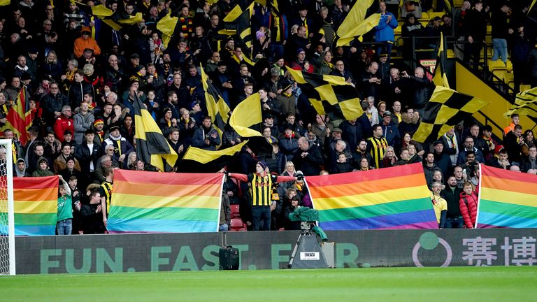 Watford fans hold up Pride flags before the game against Crystal Palace