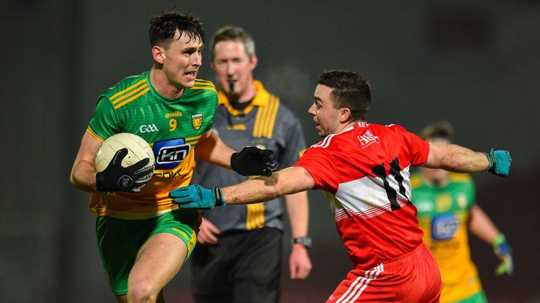 Michael Langan of Donegal in action against Niall Toner of Derry