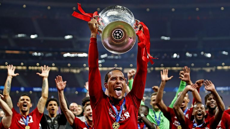 Liverpool defender Virgil van Dijk lifts the Champions League trophy aloft