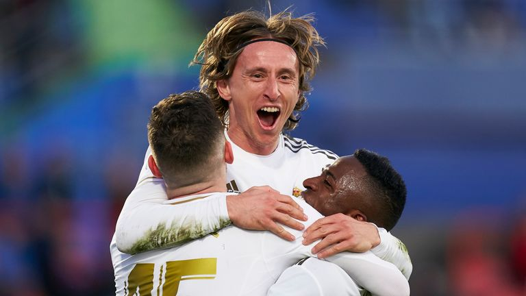Luka Modric celebrates his goal with team-mates as Real extend their lead
