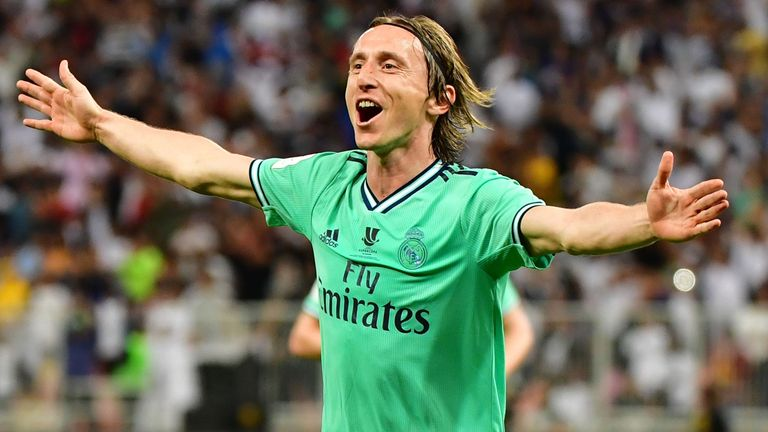 Luka Modric celebrates scoring Real Madrid's third goal