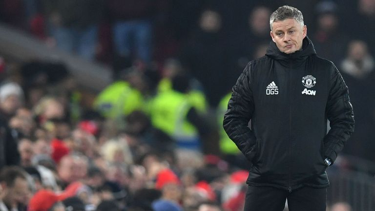 Solskjaer looks on during the humbling defeat at Anfield
