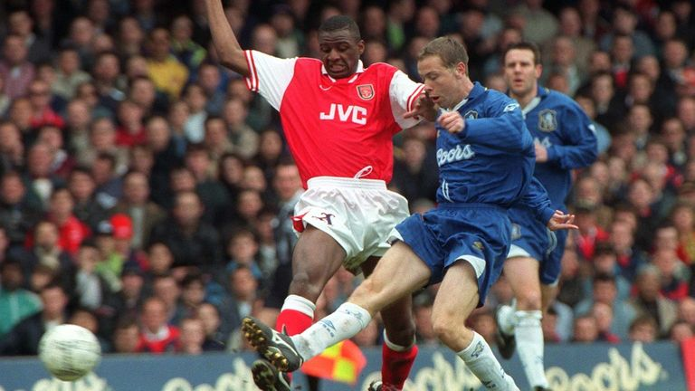 Hughes competes for the ball with Arsenal's Patrick Vieira