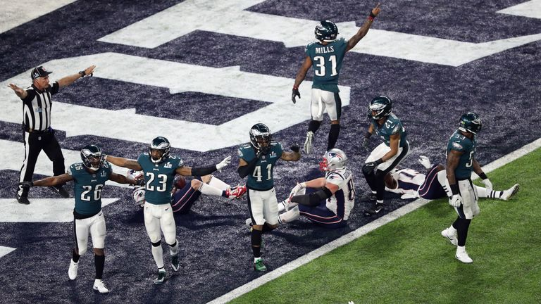 Kelce and Johnson watched from the sideline as the Eagles secured the win on the final play of the game