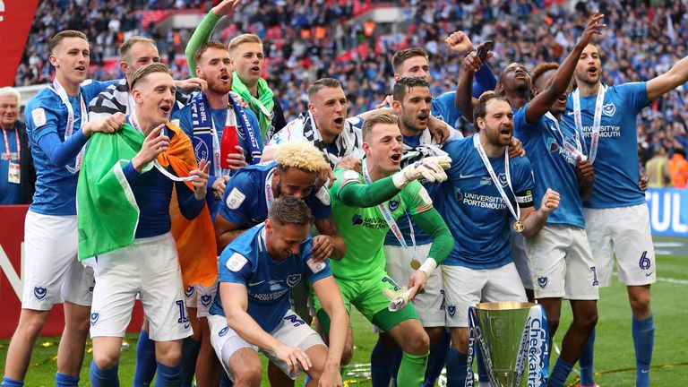 Portsmouth players celebrate winning the Checkatrade Trophy at Wembley in 2019