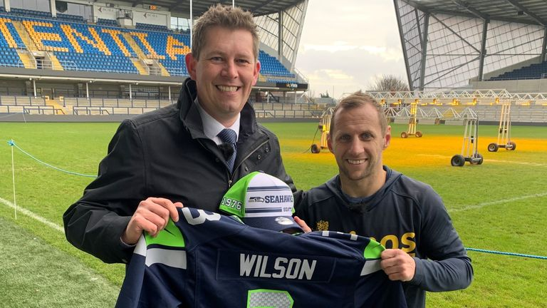Rob Burrow poses with Sky Sports News reporter Richard Graves after being surprised with Super Bowl LIV tickets