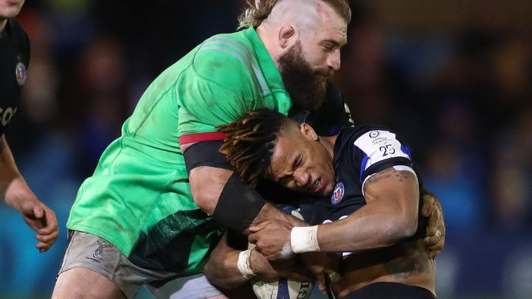 Anthony Watson is tackled by England team-mate Joe Marler