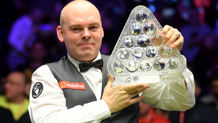 Bingham, nicknamed 'Ball-run' poses with the Paul Hunter Trophy after victory over Ali Carter at this year's Masters at Ally Pally