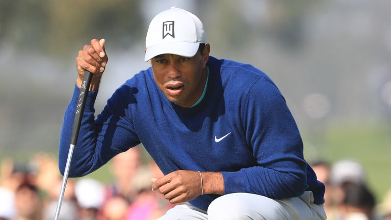 Woods holed a 15-foot par putt at the last