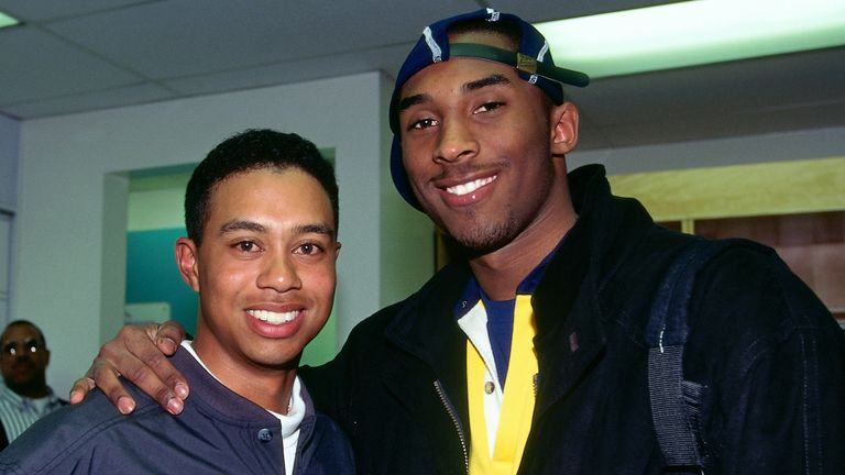 A young Tiger Woods with Bryant in 1997