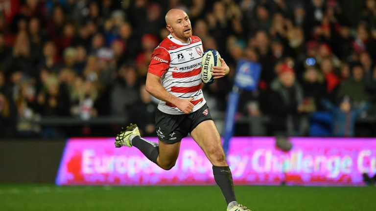 Willi Heinz makes a break to score Gloucester's first try