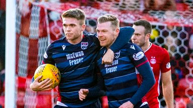 Billy McKay (R) celebrates after netting Ross County's second goal against Aberdeen