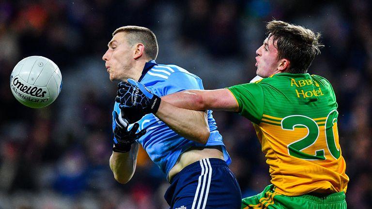 John Small of Dublin in action against Peadar Mogan of Donegal