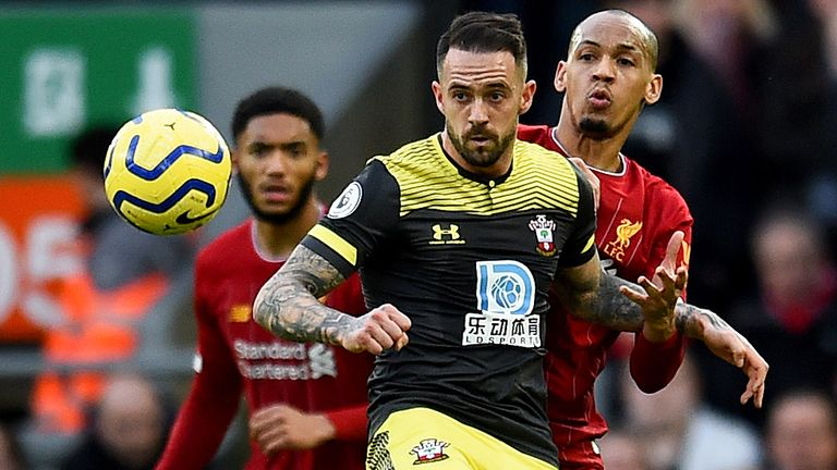 Fabinho and Danny Ings in Premier League action at Anfield
