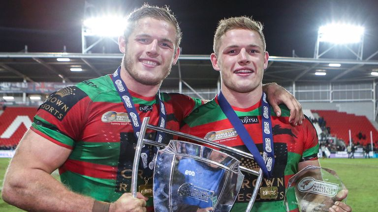 The Rabbitohs' George Burgess (right) and Tom Burgess (left) celebrate beating St Helens