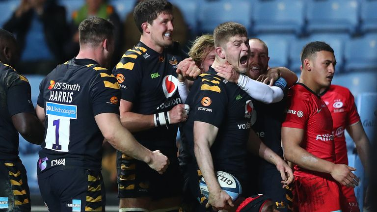 Jack Willis celebrates after scoring a try for Wasps