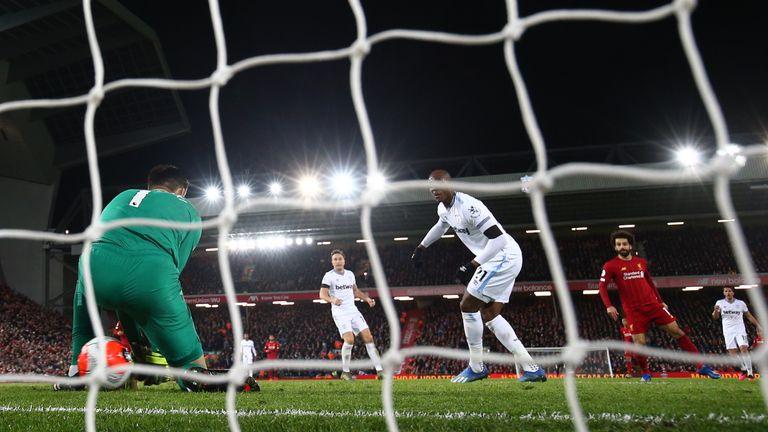 Lukasz Fabianski allows Mohamed Salah's shot to creep underneath his body