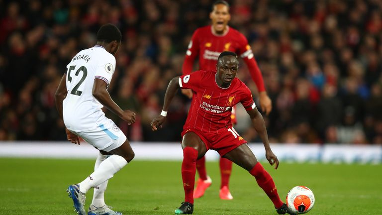 Ngakia in action against Premier League champions Liverpool at Anfield