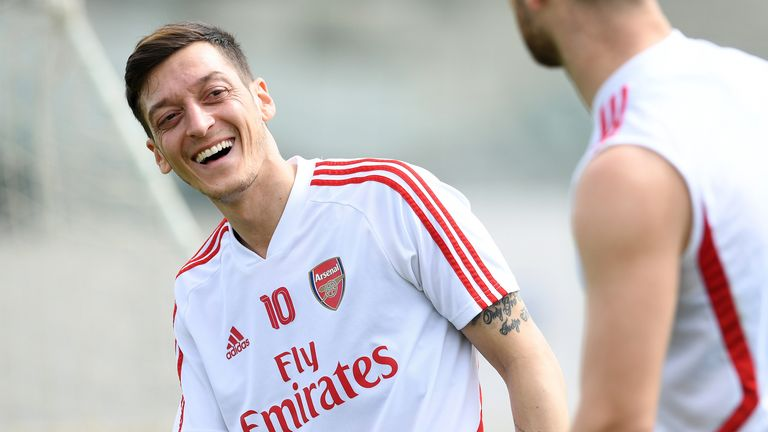 Mesut Ozil appeared in good spirits during warm-weather training in Dubai