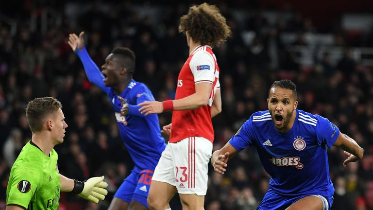 Youssef El Arabi of Olympiakos FC celebrates after scoring his team's second goal against Arsenal