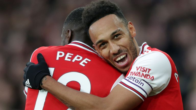 Pierre-Emerick Aubameyang celebrates with Nicolas Pepe after making it 3-2 to Arsenal against Everton