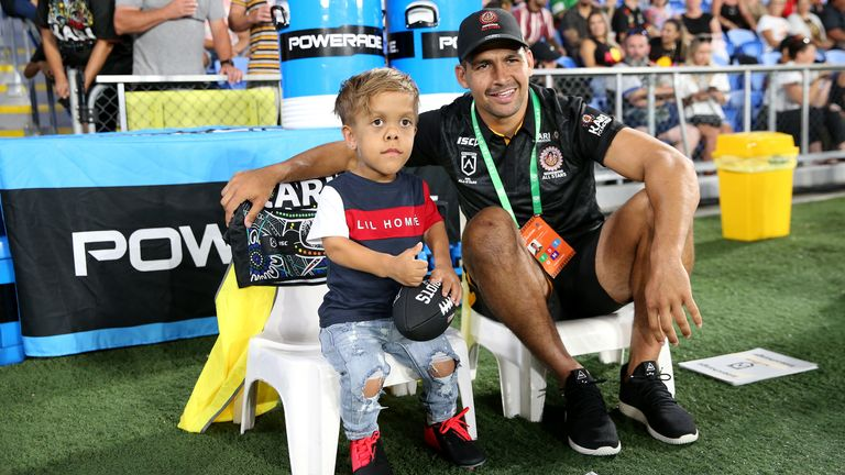 Cody Walker with Quaden Bayles  from the sidelines of the Indigenous All-Stars game