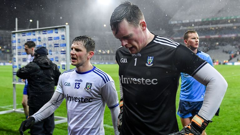 The Monaghan players cut dejected figures at full-time