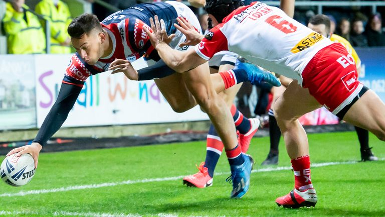 Joseph Manu stretches to score his first try