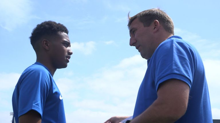 McCallum speaks with Alan Stubbs while attending the V9 Academy in 2018